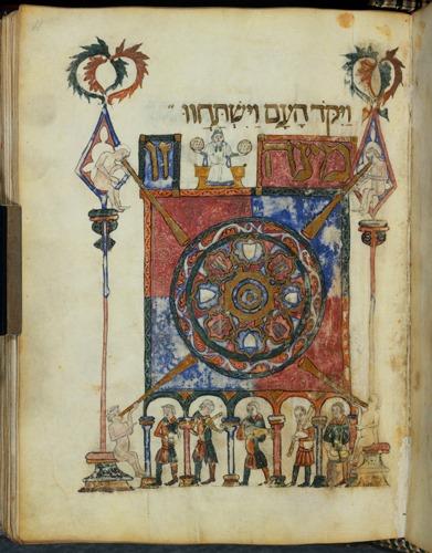 6. (f. 28v) : table du Seder avec lettrine ornée et dorée, et représentation d'un personnage posant une corbeille de pain sans levain sur la tête d'un participant